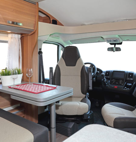Camping van interior cabin with seating for four